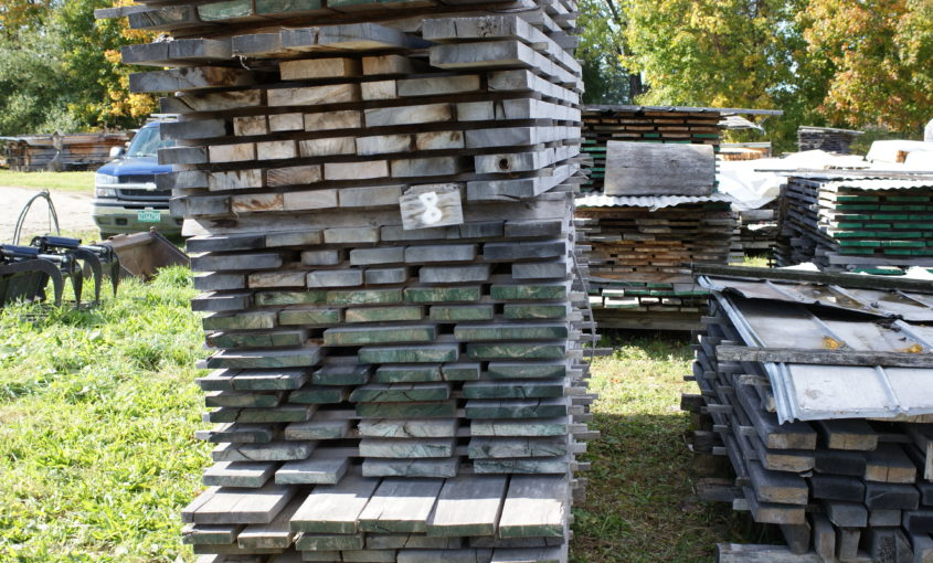 Stack of planks and assorted lumber/timber.