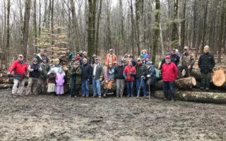 A large group gathered for a tour of timber harvest at the Stone property in Wallingford, VT. The warm wet winter day shut down logging for the remainder of the season.