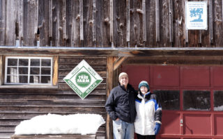 Couple With Tree Farm Sign